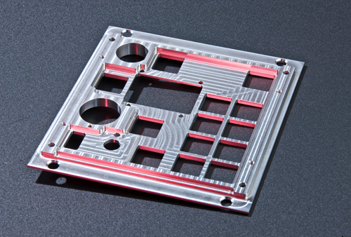 A CNC milling switch mounting plate - a precision component for the motorsport industry.
